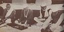 Prayer meeting at the Sabarmati Ashram on the birthday of Gandhiji : Purushottamdas Tandon, Jawaharlal Nehru, Mavalankar and Morarji Desai taking part in the spinning